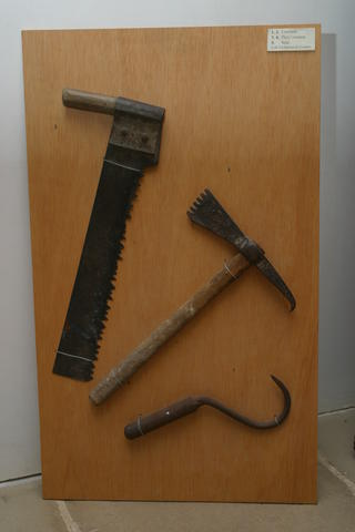Saw,       pick axe and hook